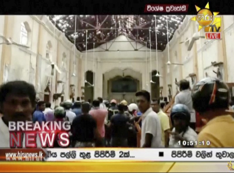 ADDS THE DETAIL OF THE PLACE - This image made from video provided by Hiru TV shows damage inside St. (Hiru TV via AP)