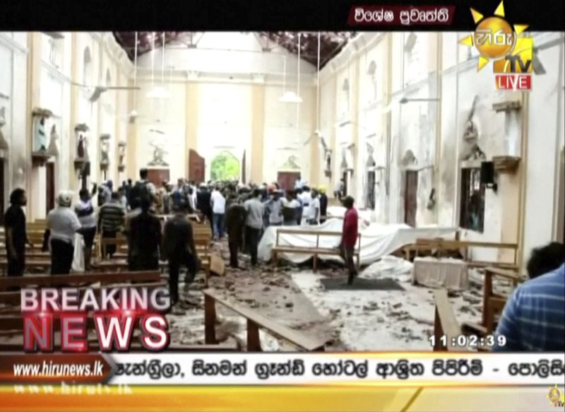 ADDS DETAIL OF THE PLACE - This image made from video provided by Hiru TV shows damage inside St. Anthony's Shrine after a blast in Colombo, Sunday, April 21, 2019. (Hiru TV via AP)