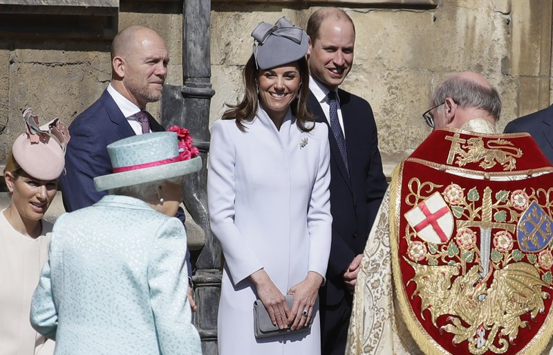 Members of Britain's Royal family watch as Britain's Queen Elizabeth II arrives to attend the Easter Mattins Service at St. (AP Photo/Kirsty Wigglesworth, pool)