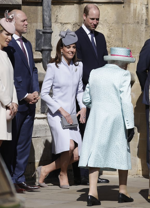 Britain's Kate, The Duchess of Cambridge curtsies as Britain's Queen Elizabeth II arrives to attend the Easter Mattins Service at St. (AP Photo/Kirsty Wigglesworth, pool)
