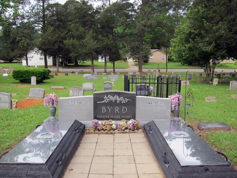 This Friday, April 12, 2019 photo shows the gravesite of James Byrd Jr. in Jasper, Texas. Byrd was killed on June 7, 1998, after he was chained to the back of a pickup truck and dragged for nearly three miles along a secluded road in the piney woods outside Jasper in what is considered one of the most gruesome hate crime murders in recent Texas history. (AP Photo/Juan Lozano)