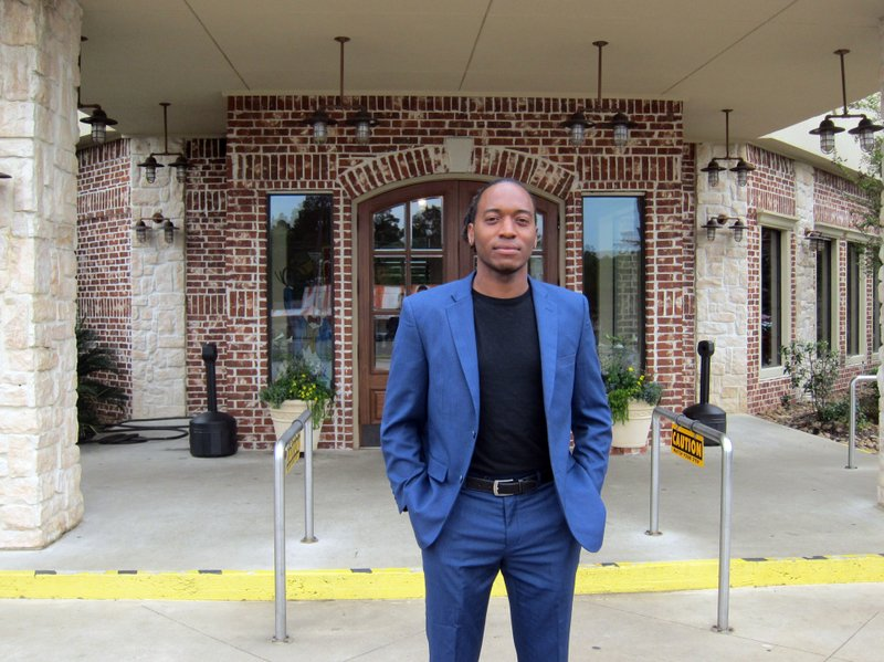 In this Friday, April 12, 2019, photo Jasper city council member Rashad Lewis stands in front of a restaurant in Jasper, Texas, after discussing the legacy of James Byrd Jr. (AP Photo/Juan Lozano)