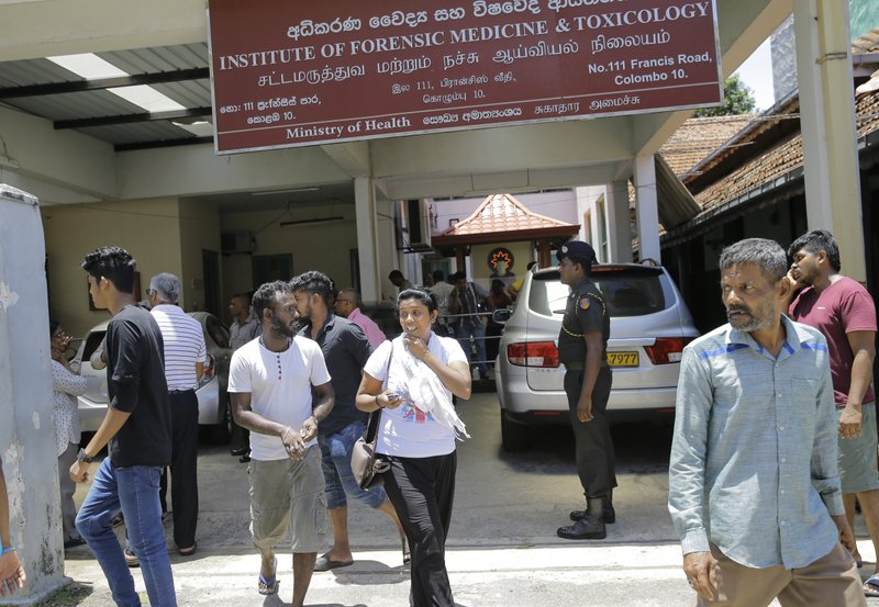 Relatives gather outside a hospital following blasts in Colombo, Sri Lanka, Sunday, April 21, 2019. More than hundred people were killed and hundreds more hospitalized from injuries in near simultaneous blasts that rocked three churches and three luxury hotels in Sri Lanka on Easter Sunday, a security official told The Associated Press, in the biggest violence in the South Asian country since its civil war ended a decade ago. (AP Photo/Eranga Jayawardena)
