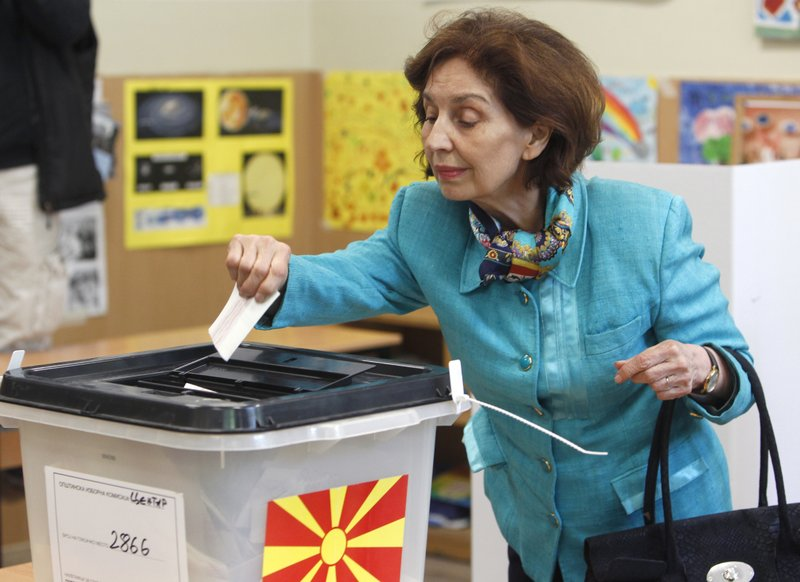 Gordana Siljanovska Davkova, a presidential candidate for the opposition conservative VMRO-DPMNE party, casts her ballot for the presidential elections at a polling station in Skopje, North Macedonia, Sunday, April 21, 2019. (AP Photo/Boris Grdanoski)