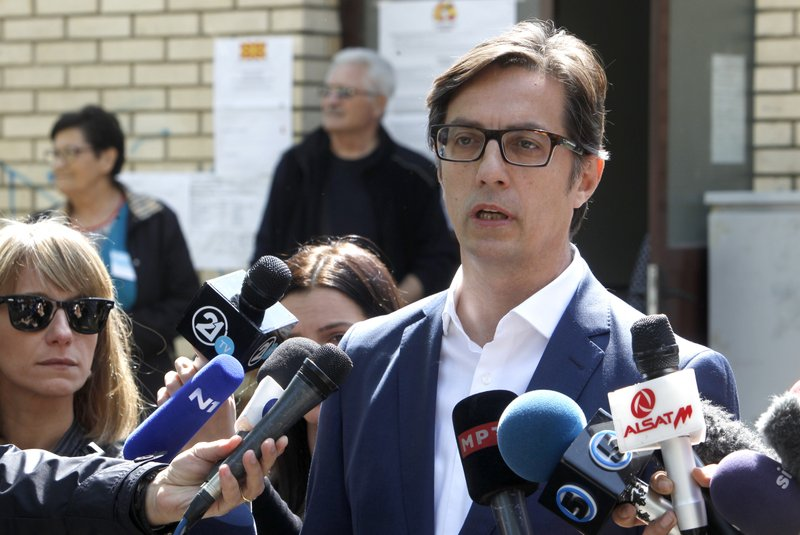 Stevo Pendarovski, presidential candidate of the ruling coalition led by the Social Democrats, talks to the media outside a polling station after voting in the presidential election in Skopje, North Macedonia, Sunday, April 21, 2019. (AP Photo/Boris Grdanoski)