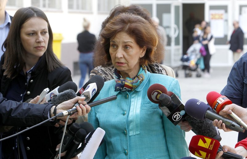 Gordana Siljanovska Davkova, a presidential candidate for the opposition conservative VMRO-DPMNE party, talks to the media outside a polling station, after voting in the presidential elections, in Skopje, North Macedonia, Sunday, April 21, 2019. (AP Photo/Boris Grdanoski)
