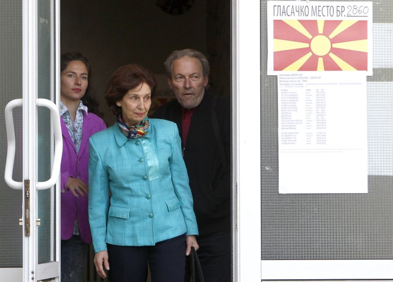 Gordana Siljanovska Davkova, center, a presidential candidate for the opposition conservative VMRO-DPMNE party, accompanied by her husband Blagoja and daughter Marija leaves a polling station after voting in the presidential elections, in Skopje, North Macedonia, Sunday, April 21, 2019. (AP Photo/Boris Grdanoski)