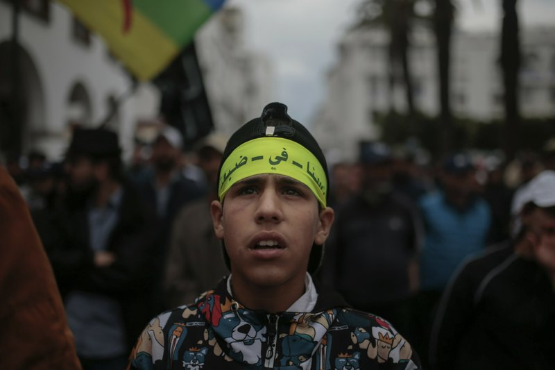 A protester takes part in a demonstration in Rabat, Morocco, Sunday, April 21, 2019. Protesters are condemning prison terms for the leader of the Hirak Rif protest movement against poverty and dozens of other activists. (AP Photo/Mosa'ab Elshamy)