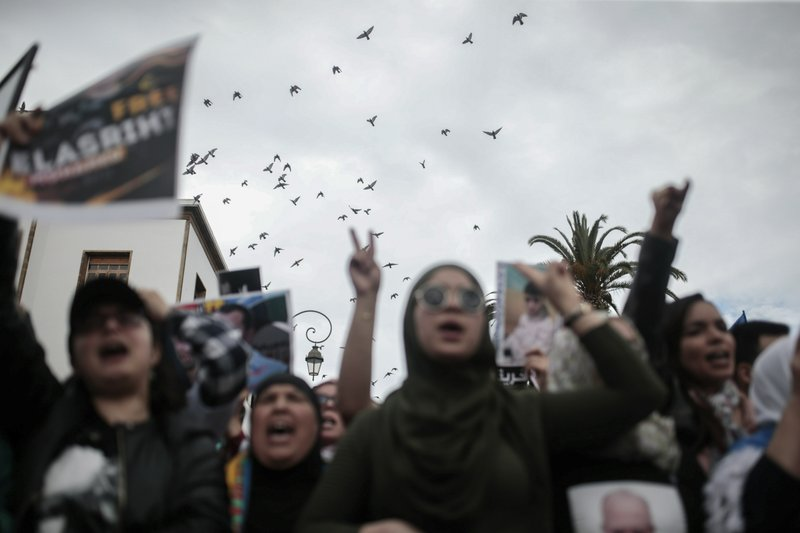 Birds fly as Moroccans gesture and chant slogans during a demonstration in Rabat, Morocco, Sunday, April 21, 2019. (AP Photo/Mosa'ab Elshamy)