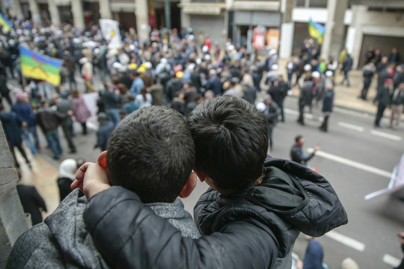 Young boys observe as thousands of Moroccans take part in a demonstration in Rabat, Morocco, Sunday, April 21, 2019. (AP Photo/Mosa'ab Elshamy)