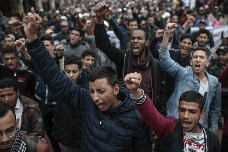 Moroccans gesture and chant slogans as they take part in a demonstration in Rabat, Morocco, Sunday, April 21, 2019. (AP Photo/Mosa'ab Elshamy)