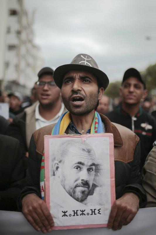 A protester holds a photo of Hirak leader Nasser Zefzafi during a demonstration in Rabat, Morocco, Sunday, April 21, 2019. (AP Photo/Mosa'ab Elshamy)