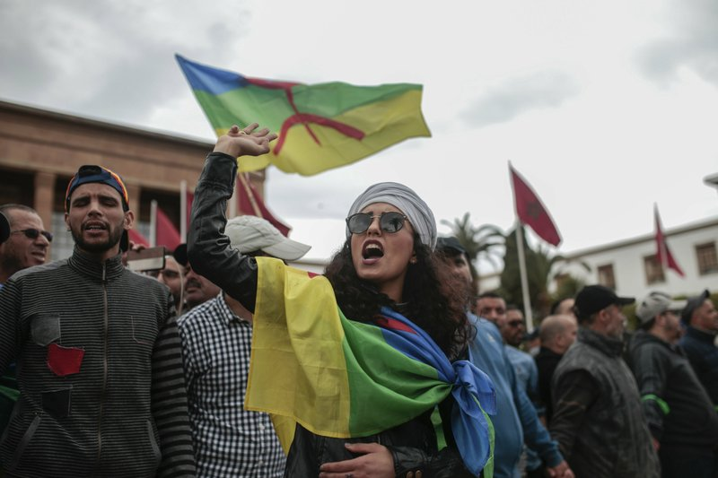 Moroccans wave Berber flags and chant slogans as they take part in a demonstration in Rabat, Morocco, Sunday, April 21, 2019. (AP Photo/Mosa'ab Elshamy)
