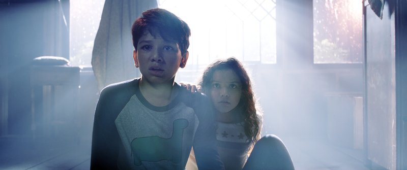 This image released by Warner Bros. Pictures shows Roman Christou, left, and Jaynee-Lynne Kinchen in a scene from