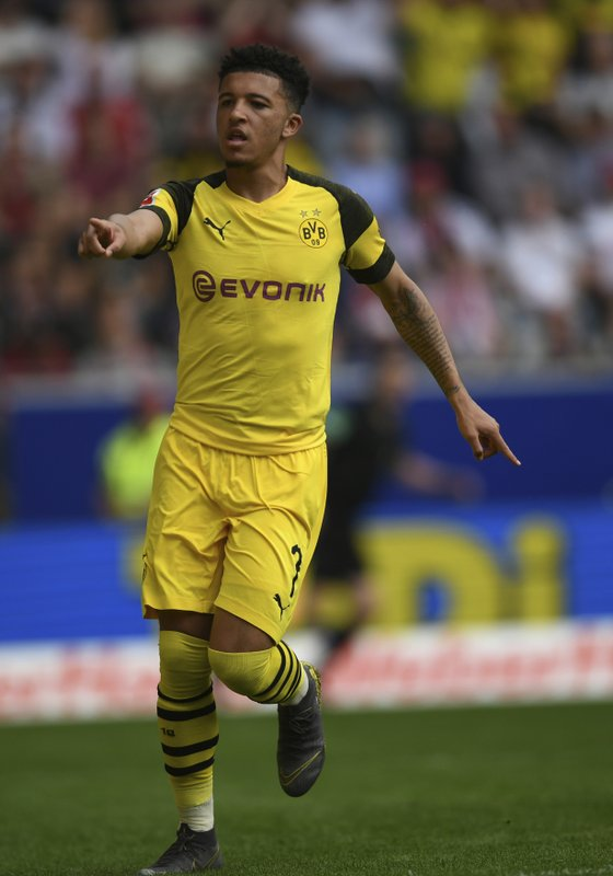 Dortmund's scorer Jadon Sancho celebrates his opening goal during the German Bundesliga soccer match between SC Freiburg and Borussia Dortmund in Freiburg, Germany, Sunday, April 21, 2019. (Patrick Seeger/dpa via AP)