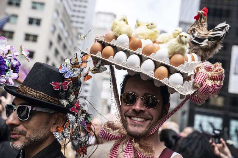 Participants wearing costumes and hats march during the Easter Parade and Bonnet Festival, Sunday, April 21, 2019, in New York. (AP Photo/Jeenah Moon)