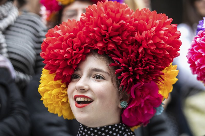 A participants wears a hat during the Easter Parade and Bonnet Festival, Sunday, April 21, 2019 in New York. (AP Photo/Jeenah Moon)