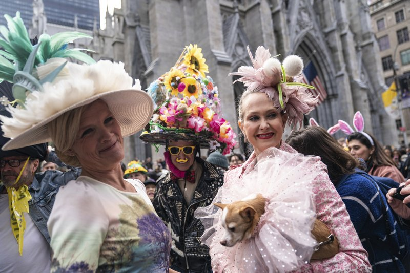 Participants wearing costumes and hats march during the Easter Parade and Bonnet Festival, Sunday, April 21, 2019 in New York. (AP Photo/Jeenah Moon)