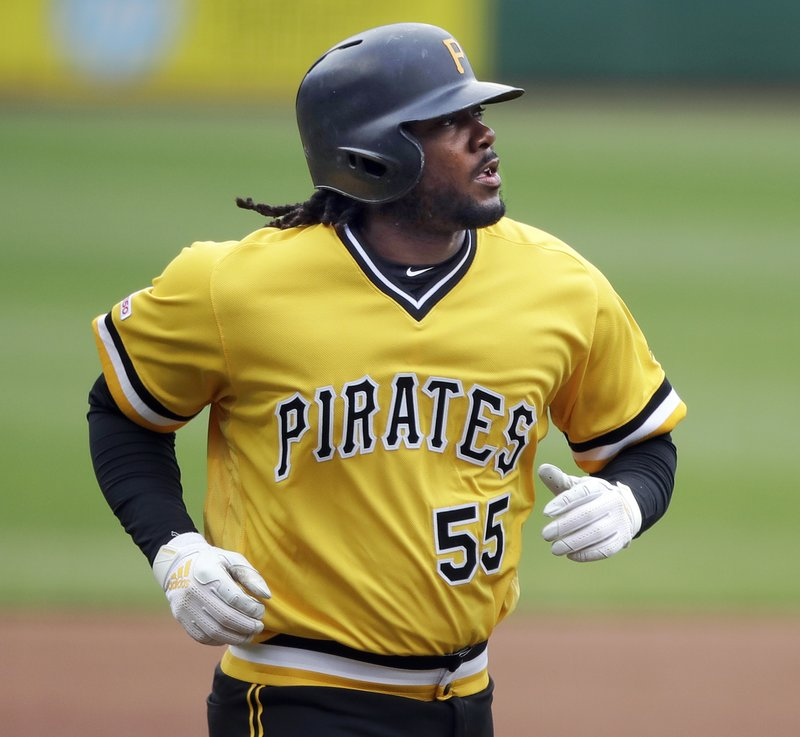 CORRECTS TO FOURTH INNING- Pittsburgh Pirates' Josh Bell rounds third after hitting a two-run home run off San Francisco Giants starting pitcher Dereck Rodriguez in the fourth inning of a baseball game in Pittsburgh, Sunday, April 21, 2019. (AP Photo/Gene J. Puskar)