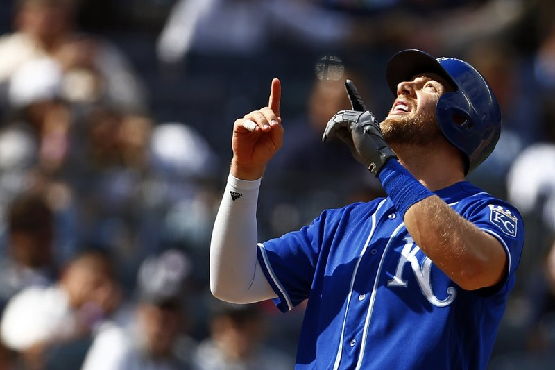 Kansas City Royals' Hunter Dozier celebrates his solo home run during the eighth inning of a baseball game against the New York Yankees on Sunday, April 21, 2019, in New York. (AP Photo/Adam Hunger)