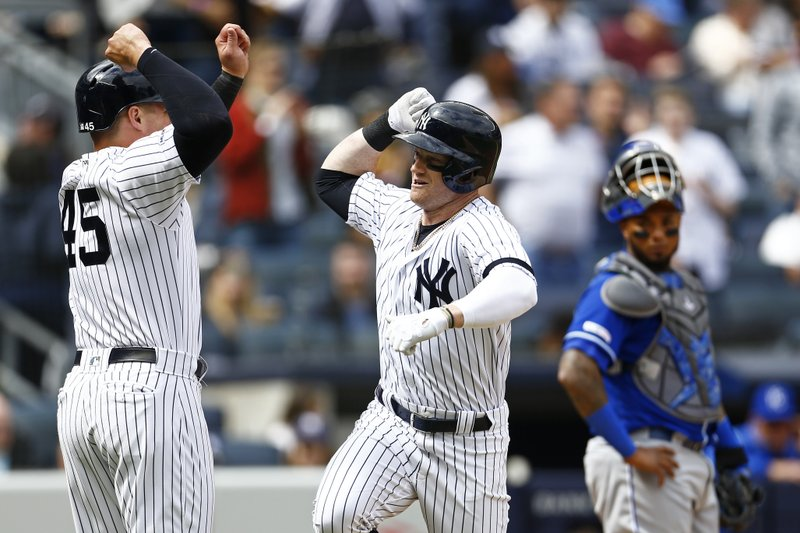 New York Yankees' Clint Frazier, center, celebrates his three-run home run with Yankees' Luke Voit (45) in front of Kansas City Royals catcher Martin Maldonado during the fifth inning of a baseball game against the Kansas City Royals on Sunday, April 21, 2019, in New York. (AP Photo/Adam Hunger)