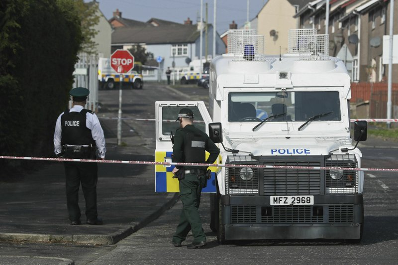 Police at the scene in Londonderry, Northern Ireland, Friday April 19, 2019, following the death of 29-year-old journalist Lyra McKee who was shot and killed during overnight rioting. (Brian Lawless/PA via AP)
