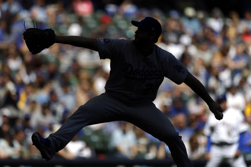 Los Angeles Dodgers' Clayton Kershaw pitches during the third inning of a baseball game against the Milwaukee Brewers Sunday, April 21, 2019, in Milwaukee. (AP Photo/Aaron Gash)