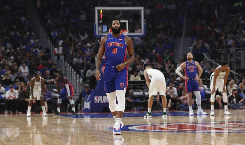 Detroit Pistons center Andre Drummond walks back to the bench after a foul during the second half of Game 3 of a first-round NBA basketball playoff series against the Milwaukee Bucks, Saturday, April 20, 2019, in Detroit. (AP Photo/Carlos Osorio)