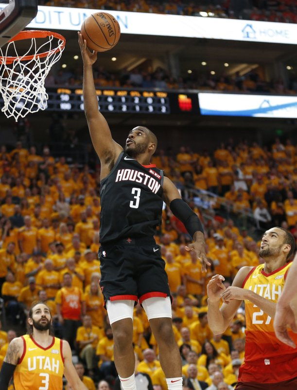 Houston Rockets guard Chris Paul (3) lays the ball up as Utah Jazz's Ricky Rubio (3) and Rudy Gobert, right, look on in the first half during an NBA basketball game Saturday, April 20, 2019, in Salt Lake City. (AP Photo/Rick Bowmer)
