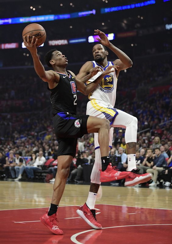 Los Angeles Clippers guard Shai Gilgeous-Alexander, left, shoots as Golden State Warriors forward Kevin Durant defends during the first half in Game 4 of a first-round NBA basketball playoff series Sunday, April 21, 2019, in Los Angeles. (AP Photo/Mark J. Terrill)
