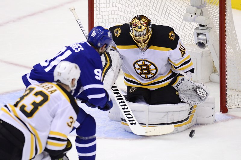 Boston Bruins goaltender Tuukka Rask (40) makes a save against Toronto Maple Leafs center John Tavares (91) during the second period of Game 6 of an NHL hockey first-round playoff series Sunday, April 21, 2019, in Toronto. (Frank Gunn/The Canadian Press via AP)