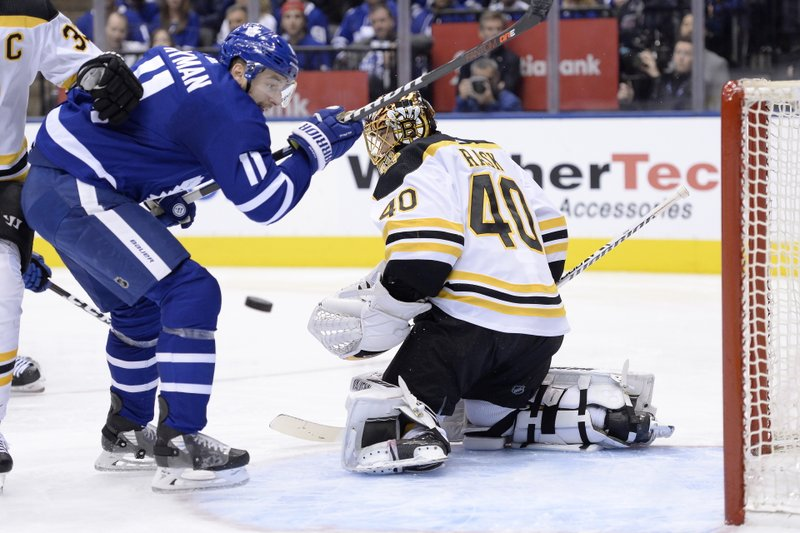 Boston Bruins goaltender Tuukka Rask (40) makes a save on a tip by Toronto Maple Leafs left wing Zach Hyman (11) during second period NHL playoff hockey action in Toronto on Sunday, April 21, 2019. (Nathan Denette/The Canadian Press via AP)