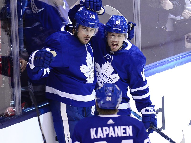 Toronto Maple Leafs center Auston Matthews (34) celebrates his goal with left wing Andreas Johnsson (18) and right wing Kasperi Kapanen (24) during the third period of Game 6 of an NHL hockey first-round playoff series against the Boston Bruins Sunday, April 21, 2019, in Toronto. (Frank Gunn/The Canadian Press via AP)