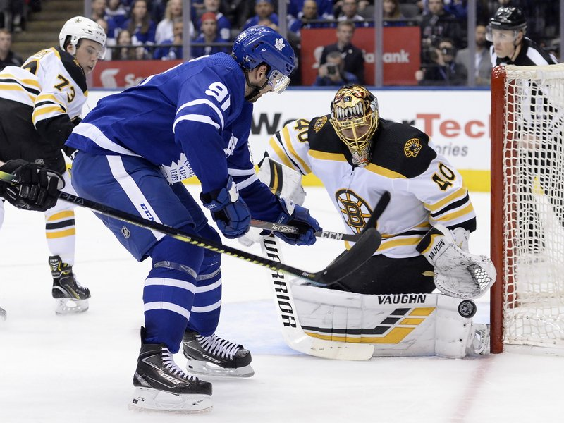 Boston Bruins goaltender Tuukka Rask (40) makes a save against Toronto Maple Leafs center John Tavares (91) during the second period of Game 6 of an NHL hockey first-round playoff series Sunday, April 21, 2019, in Toronto. (Nathan Denette/The Canadian Press via AP)