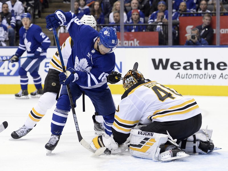 Boston Bruins goaltender Tuukka Rask (40) makes a save against Toronto Maple Leafs left wing Andreas Johnsson (18) during second period NHL playoff hockey action in Toronto on Sunday, April 21, 2019. (Nathan Denette/The Canadian Press via AP)