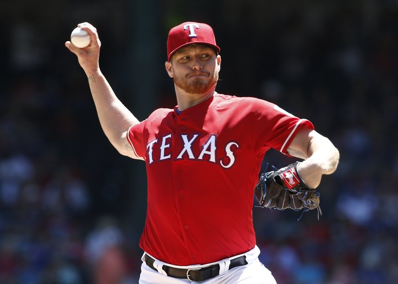 Texas Rangers starting pitcher Shelby Miller delivers against the Houston Astros during the first inning of a baseball game Sunday, April 21, 2019, in Arlington, Texas. (AP Photo/Mike Stone)