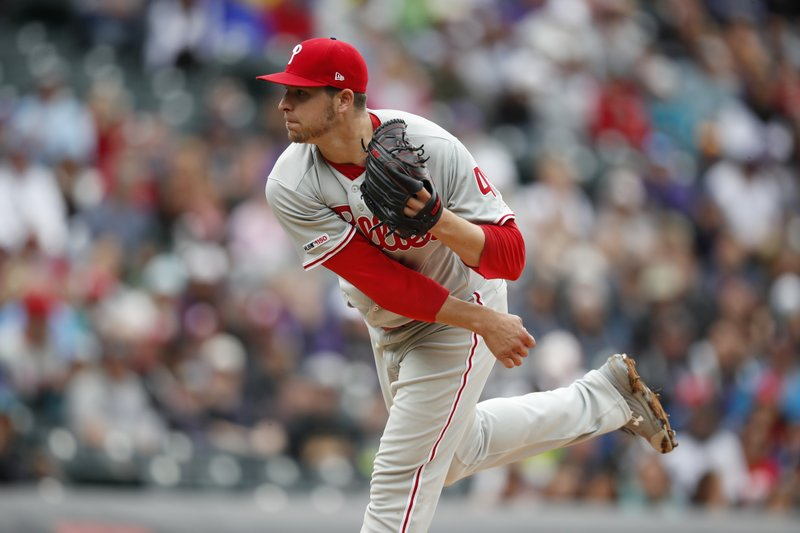 Philadelphia Phillies starting pitcher Jerad Eickhoff works against the Colorado Rockies in the first inning of a baseball game Sunday, April 21, 2019, in Denver. (AP Photo/David Zalubowski)