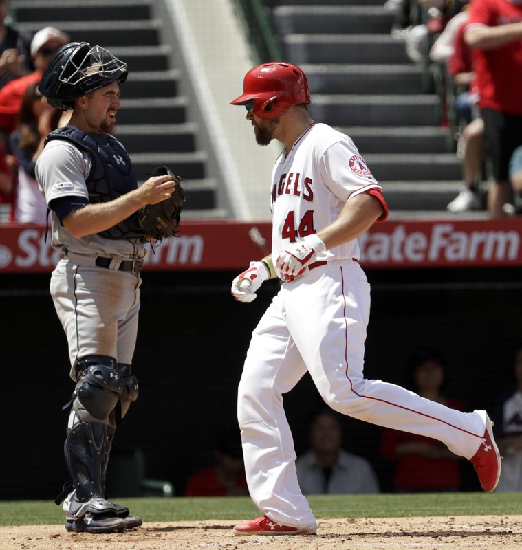 Los Angeles Angels' Kevan Smith scores past Seattle Mariners catcher Tom Murphy after a two-run home run during the second inning of a baseball game in Anaheim, Calif. (AP Photo/Chris Carlson)
