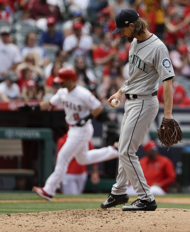 Los Angeles Angels' Tommy La Stella rounds the bases after a home run off Seattle Mariners starting pitcher Mike Leake during the fourth inning of a baseball game in Anaheim, Calif. (AP Photo/Chris Carlson)