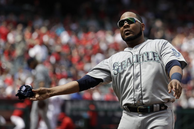 Seattle Mariners' Edwin Encarnacion throws his batting gloves after striking out against the Los Angeles Angels during the third inning of a baseball game in Anaheim, Calif. (AP Photo/Chris Carlson)