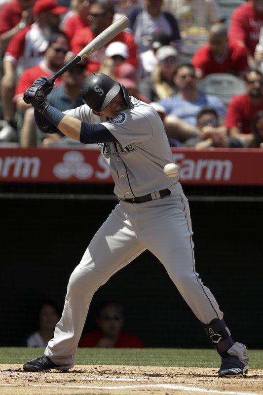 Seattle Mariners' Ryon Healy gets out way the way of an inside pitch during the second inning of a baseball game against the Los Angeles Angels in Anaheim, Calif. (AP Photo/Chris Carlson)