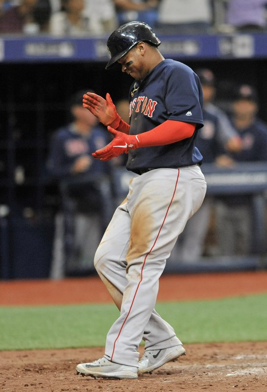 Boston Red Sox's Rafael Devers celebrates as he scores the game-winning run on a sacrifice fly ball hit by Christian Vazquez off Tampa Bay Rays reliever Jose Alvardo during the 11th inning of a baseball game Sunday, April 21, 2019, in St. (AP Photo/Steve Nesius)