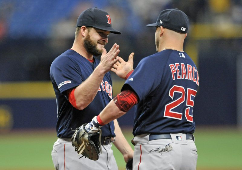 Boston Red Sox closer Ryan Brasier, left, celebrates with first baseman Steve Pearce (25) after the Red Sox beat the Tampa Bay Rays 4-3 during an 11-inning baseball game Sunday, April 21, 2019, in St. (AP Photo/Steve Nesius)