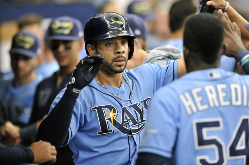 Tampa Bay Rays teammates greet Tommy Pham, center, after his solo home run off Boston Red Sox reliever Matt Barnes during the eighth inning of a baseball game Sunday, April 21, 2019, in St. (AP Photo/Steve Nesius)