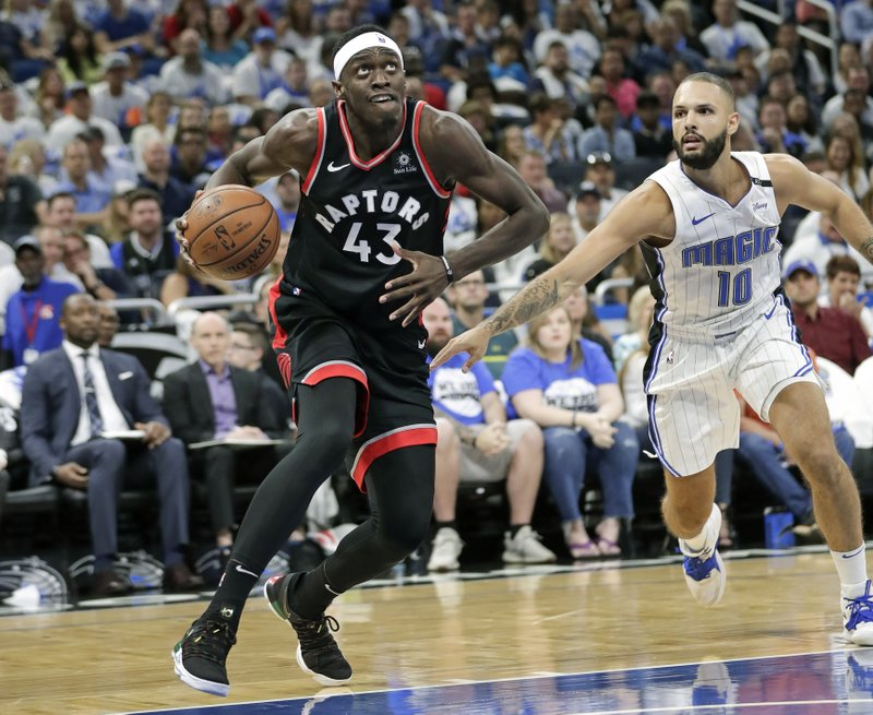 Toronto Raptors' Pascal Siakam (43) goes to the basket as he gets past Orlando Magic's Evan Fournier (10) during the first half in Game 4 of a first-round NBA basketball playoff series, Sunday, April 21, 2019, in Orlando, Fla. (AP Photo/John Raoux)