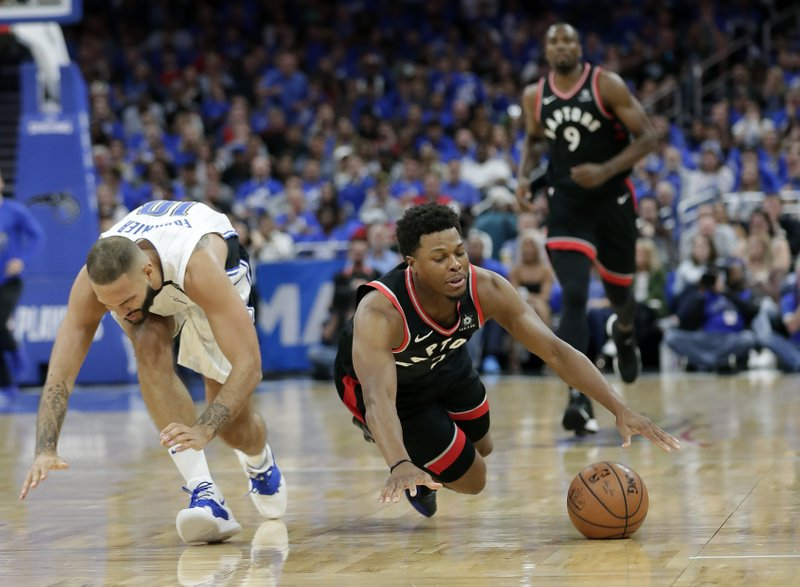 Toronto Raptors' Kyle Lowry, front right, falls to the floor after he is fouled by Orlando Magic's Evan Fournier, left, during the first half in Game 4 of a first-round NBA basketball playoff series, Sunday, April 21, 2019, in Orlando, Fla. (AP Photo/John Raoux)