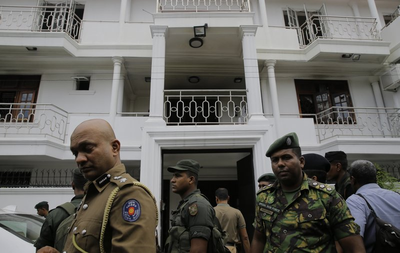 Sri Lankan security forces officers secure a site believed to be a hide out of the militants following a shoot out in Colombo, Sri Lanka, Sunday, April 21, 2019. (AP Photo/Eranga Jayawardena)