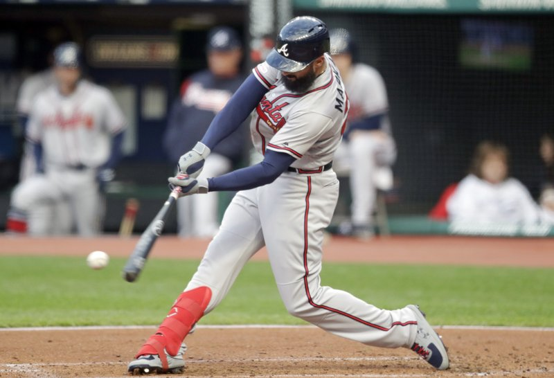 Atlanta Braves' Nick Markakis hits a one-run double off Cleveland Indians starting pitcher Shane Bieber in the first inning of a baseball game, Sunday, April 21, 2019, in Cleveland. (AP Photo/Tony Dejak)