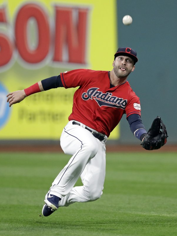 Cleveland Indians' Tyler Naquin catches a ball hit by Atlanta Braves' Dansby Swanson in the fourth inning of a baseball game, Sunday, April 21, 2019, in Cleveland. (AP Photo/Tony Dejak)