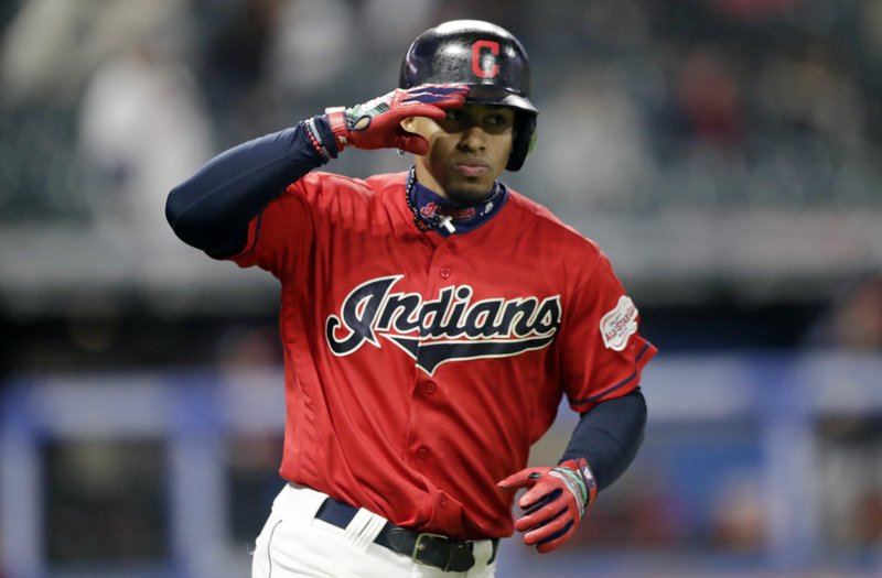 Cleveland Indians' Francisco Lindor salutes after hitting a solo home run off Atlanta Braves starting pitcher Max Fried in the seventh inning of a baseball game, Sunday, April 21, 2019, in Cleveland. (AP Photo/Tony Dejak)